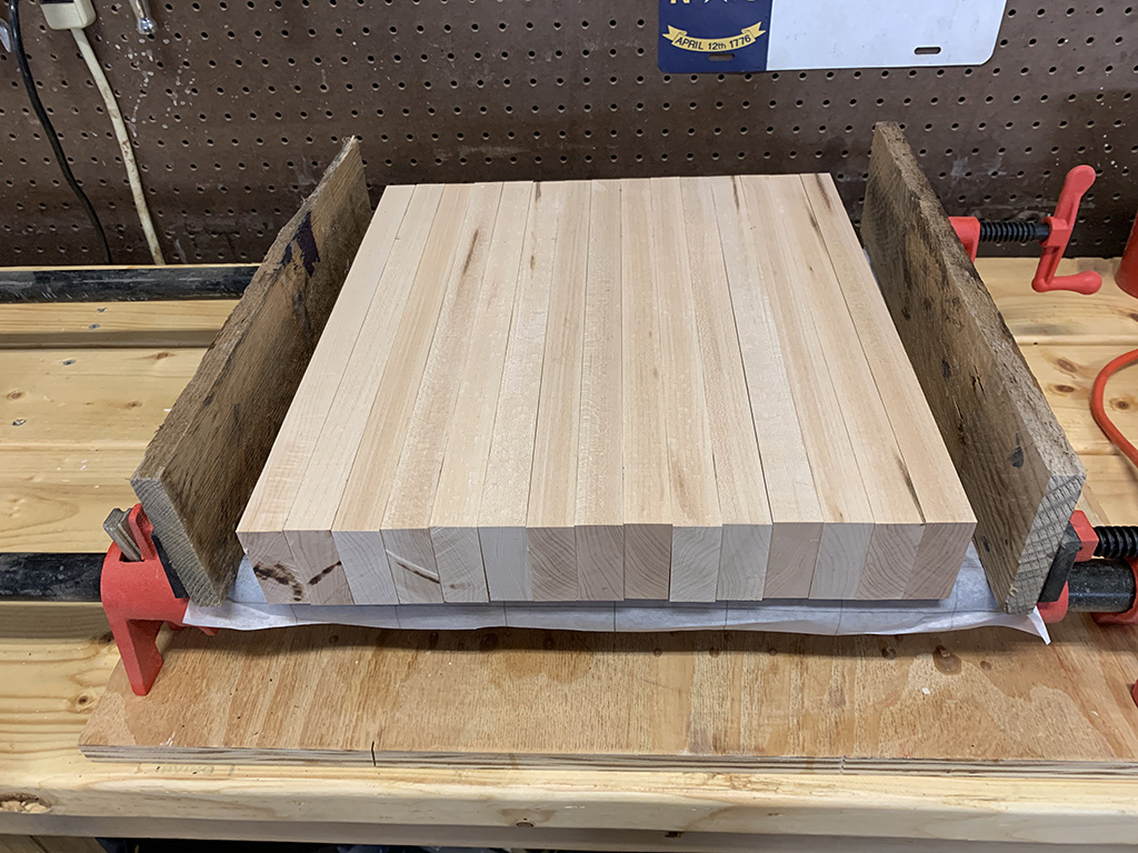 Slats are glued here and ready to be cut to build an end-grain cutting board.